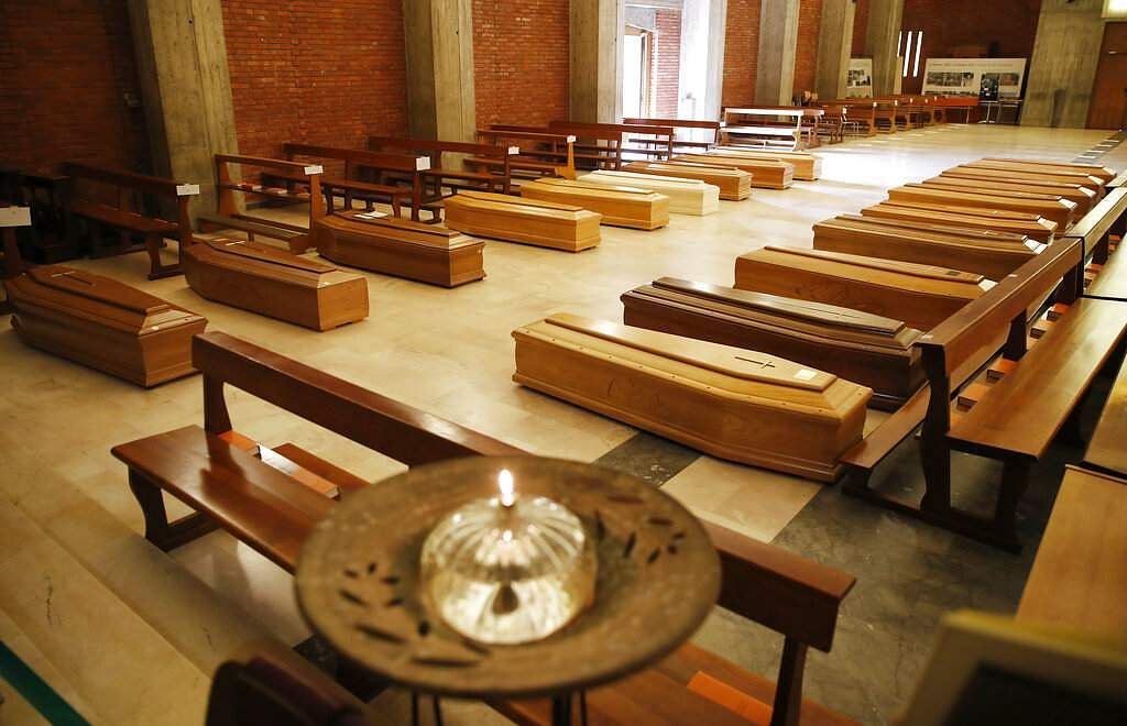 Bergamo, Italy: Coffins are lined up on the floor in the San Giuseppe church in Seriate, one of the areas worst hit by the coronavirus, waiting to be taken to a crematory. (AP Photo/Antonio Calanni)