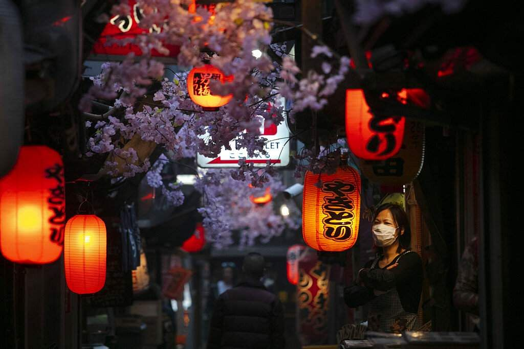 Tokyo, Japan: A cook wearing a face mask stands outside a restaurant in Tokyo. (AP Photo/Jae C Hong)