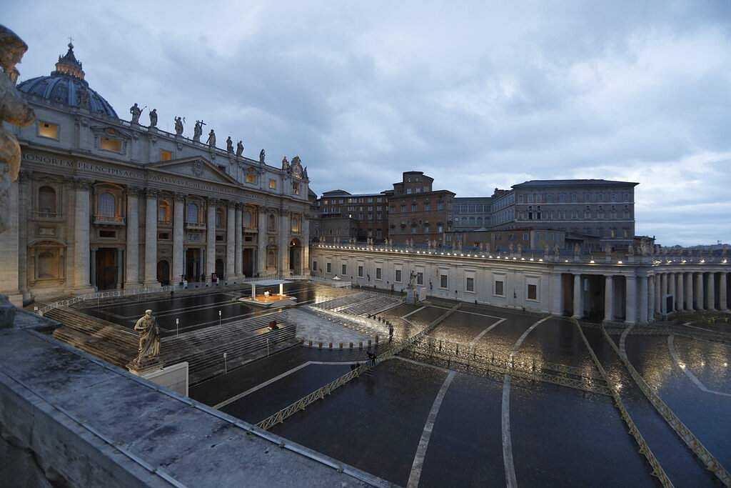 Vatican City: Pope Francis, a small white figure at the centre beneath the canopy, delivers an Urbi et orbi prayer from the empty St Peter's Square, at the Vatican. (Yara Nardi/Pool Photo via AP)