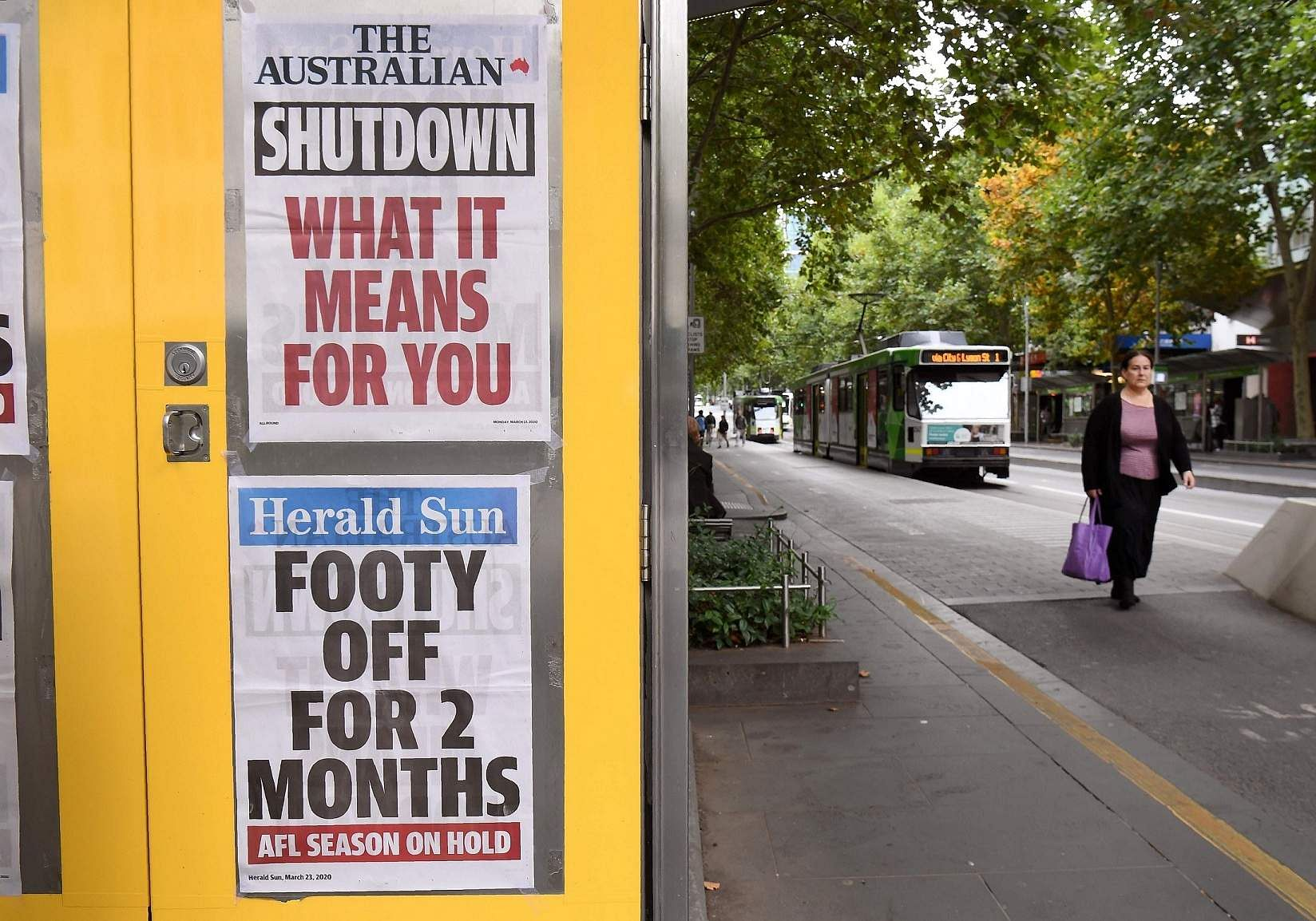 Melbourne, Victoria, Australia: Newspaper headlines are pasted to the side of a newspaper stand in Melbourne. (AFP/William WEST)