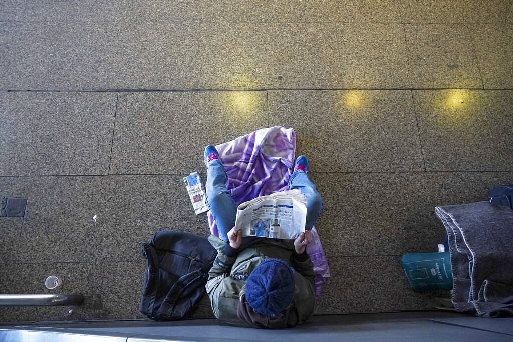Rome, Italy: A person reads a newspaper in an almost empty Termini main train station, in Rome. (AP Photo/Andrew Medichini)