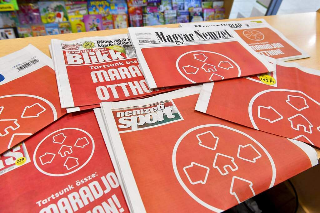 Debrecen, Hungary: Front pages of Hungarian newspapers at a news stand encourage readers to stay at home due to the coronavirus epidemic in downtown Debrecen. (Zsolt Czegledi/MTI via AP)