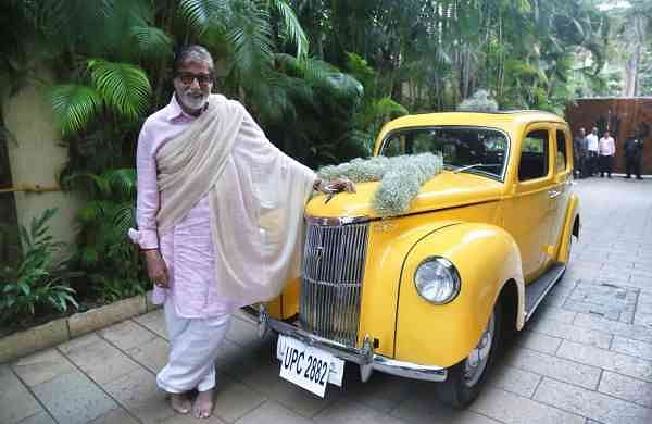 Amitabh Bachchan with his new vintage Ford (Photo: IANS)