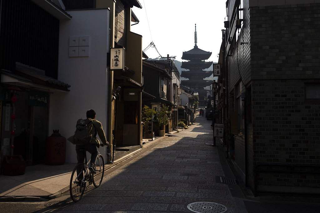 A man rides his bike toward Yasaka Pagoda in the Higashiyama district of Kyoto, Japan. Kyoto's city govt has set-up an emergency fund for affected small to medium businesses. (AP Photo/Jae C Hong)