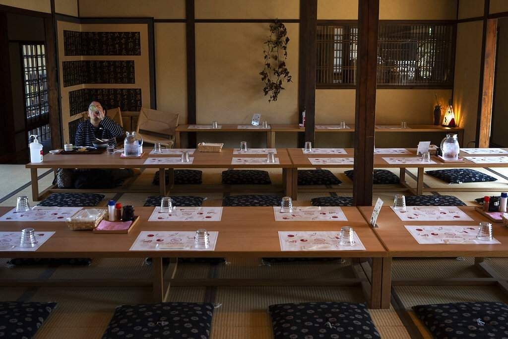 A tourist eats her lunch in a restaurant in Nara, Japan. Nara was among the first Japanese town hit by the COVID-19 in late January. (AP Photo/Jae C Hong)