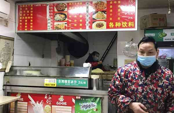 Stores owners sel the local favorite 'reganmian' or 'hot dry noodles' (AP Photo/Olivia Zhang)