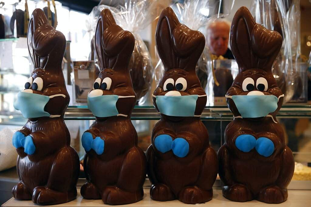 Chocolate Easter bunnies with masks are on display at a cake shop in Lykovrisi, northern Athens, Greece. (AP Photo/Thanassis Stavrakis)