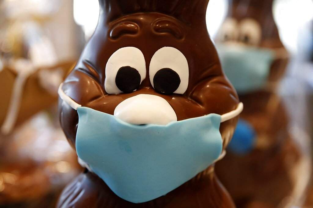 A chocolate Easter bunny with mask is on display at a cake shop in Lykovrisi, northern Athens, Greece. (AP Photo/Thanassis Stavrakis)
