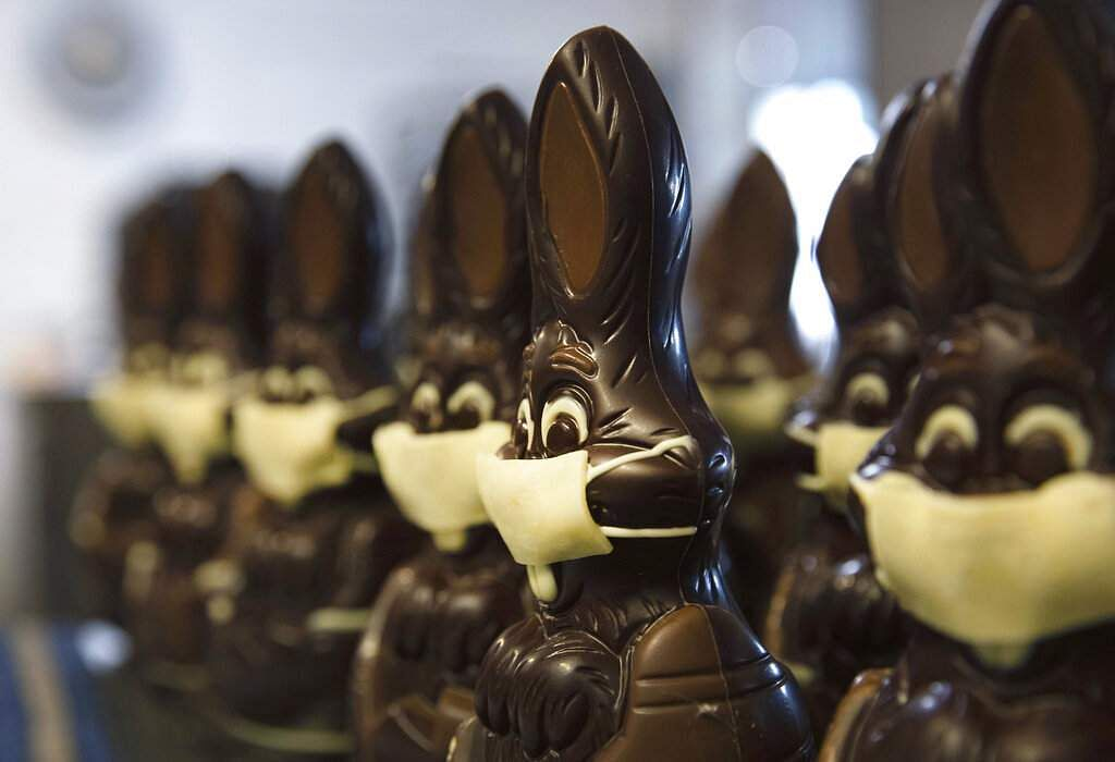 Chocolate rabbits with face masks are lined up at Cocoatree shop in Lonzee, Belgium. Many chocolatiers have resorted to online sales, home delivery or pick up on site. (AP Photo/Virginia Mayo)