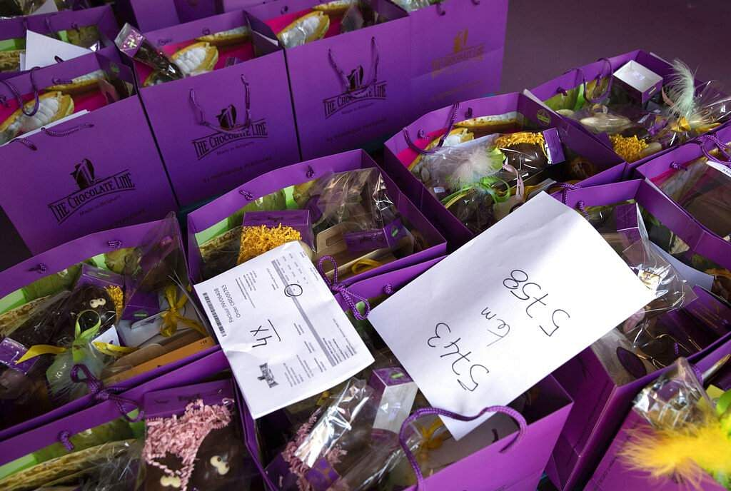 Order slips are placed on top of bags of chocolate waiting to be picked up at the Chocolate Line warehouse in Bruges, Belgium. (AP Photo/Virginia Mayo)