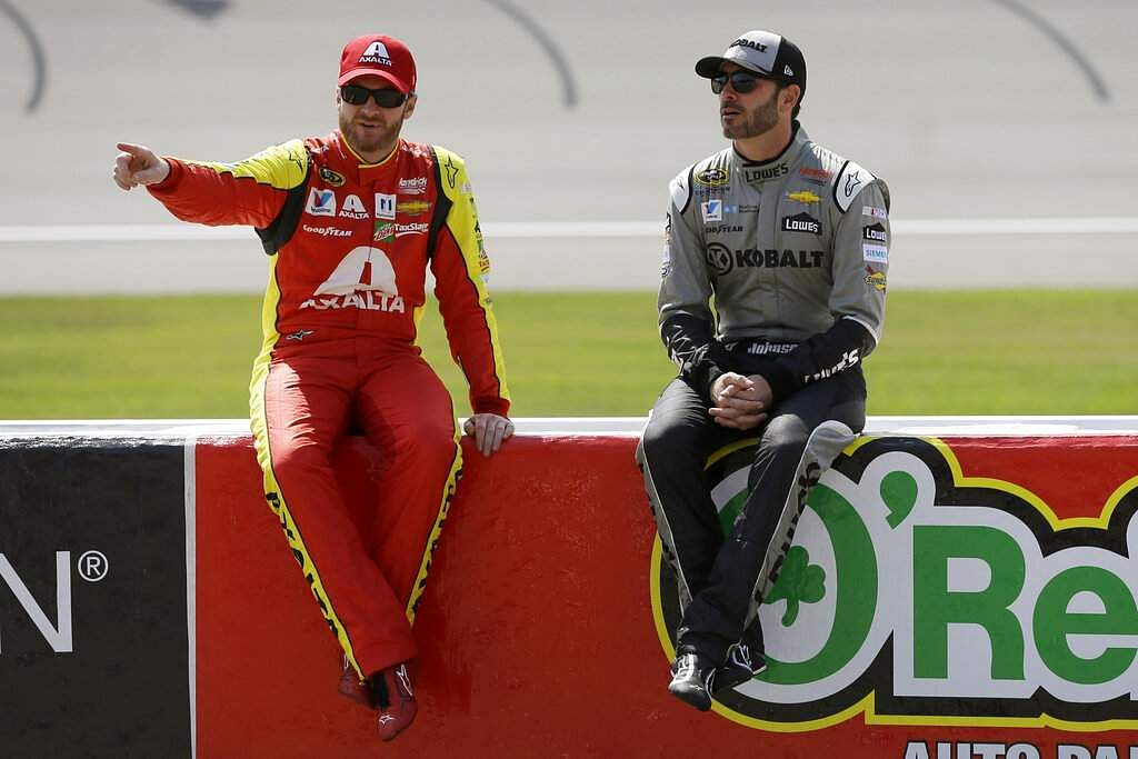 File photo: Drivers Dale Earnhardt Jr and Jimmie Johnson (AP Photo/Carlos Osorio, File)