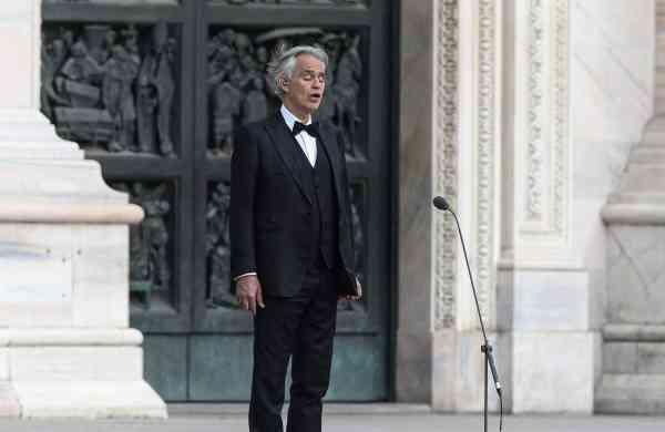 Andrea Bocelli sings in a deserted Piazza del Duomo in Milan (AFP/Piero Cruciatti)