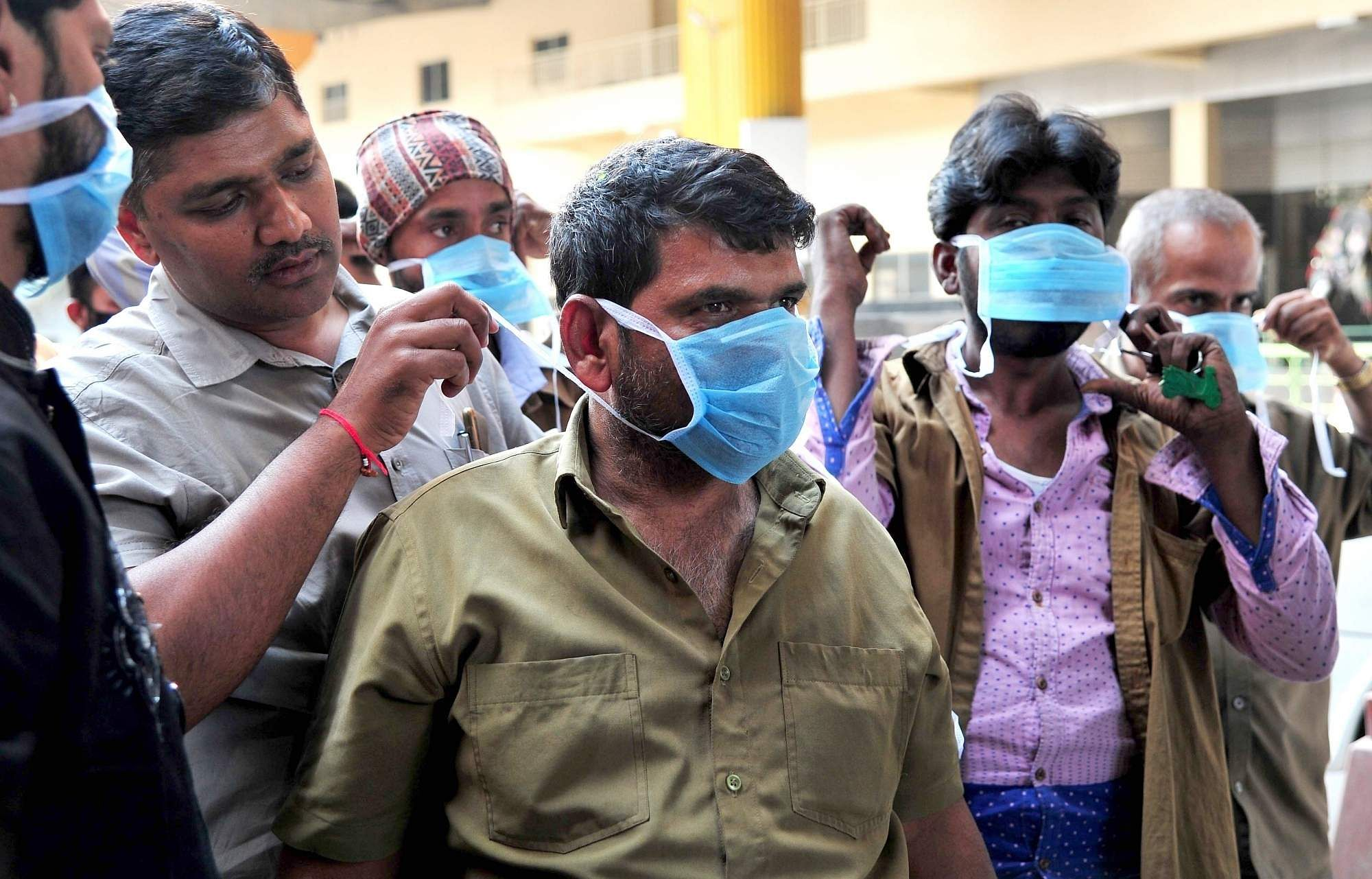 People being distributed masks as part of an awareness drive urging people to take precautionary measures against Coronavirus