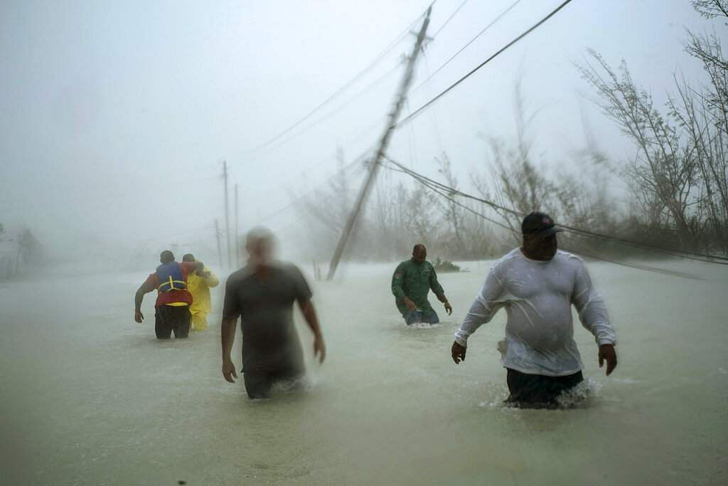 Ramon Espinosa won third prize in Spot News Singles for this pic of volunteers in Freeport, Grand Bahama after Hurricane Dorian. (Ramon Espinosa, The Associated Press, World Press Photo via AP)