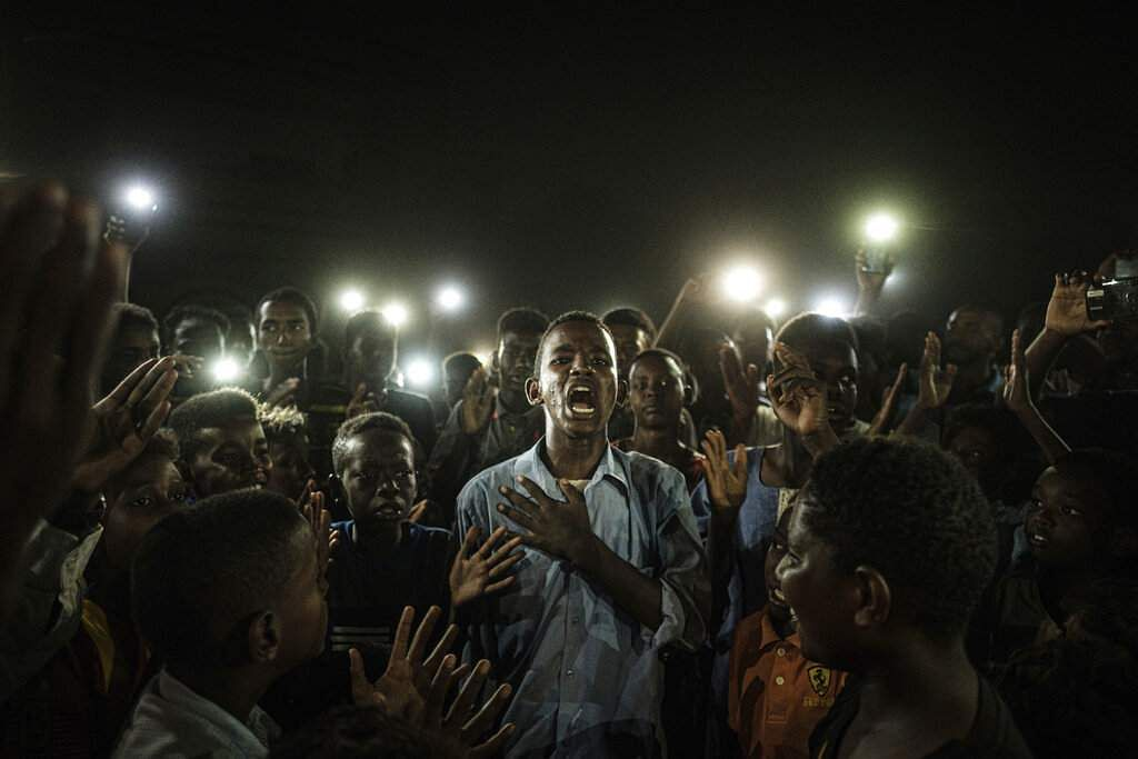 Yasuyoshi Chiba won the World Press Photo of the Year award and first prize in the General News Singles category for this shot in Khartoum, Sudan. (Yasuyoshi Chiba, AFP/World Press Photo via AP)
