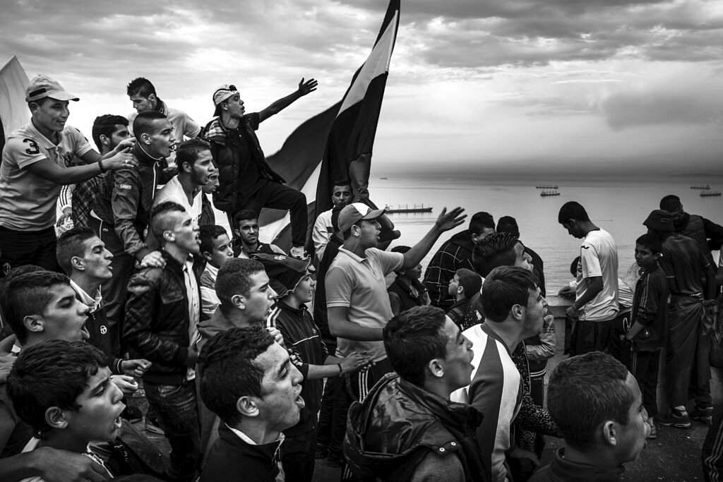 Romain Laurendeau won the World Press Photo Story of the Year and first prize in the Long Term Projects category for this pic of football fans in Algiers. (Romain Laurendeau, World Press Photo via AP)