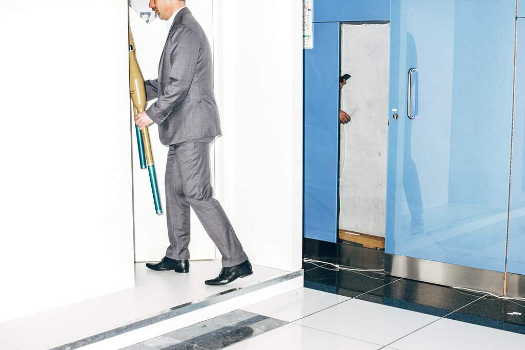 Nikita Teryoshin won first prize in Contemporary Issues Singles for this pic of a businessman locking away anti-tank grenade launchers in Abu Dhabi. (Nikita Teryoshin, World Press Photo via AP)