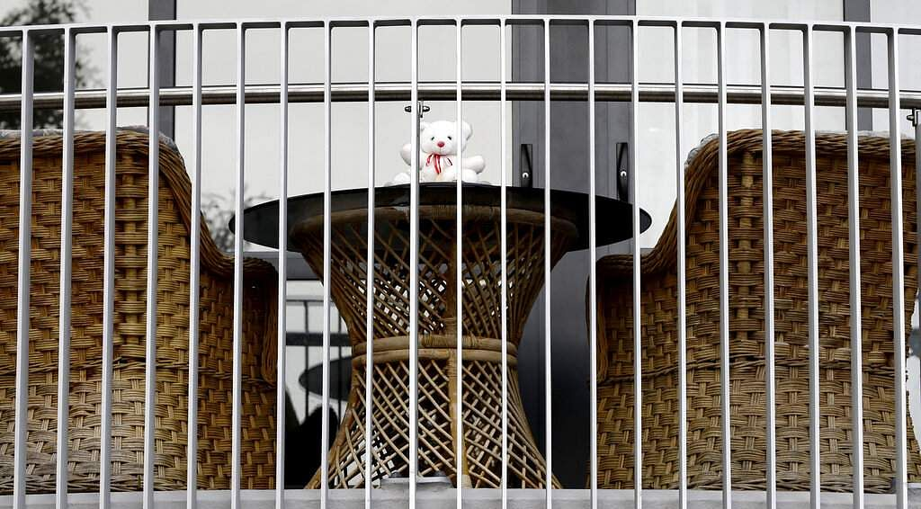 A teddy bear in the balcony of a house in Christchurch. New Zealanders are embracing a global movement in which people place teddies in their windows to brighten the mood. (AP Photo/Mark Baker)