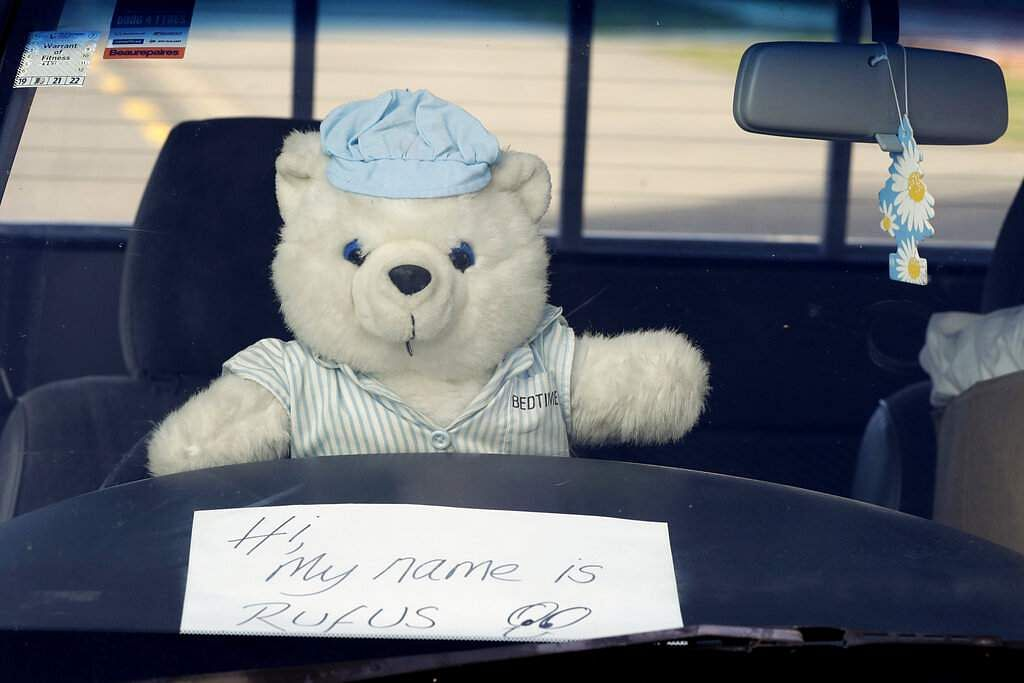 A teddy bear at the wheel of a car in Christchurch. New Zealanders are embracing a global movement in which people place teddies in their windows to brighten the mood. (AP Photo/Mark Baker)