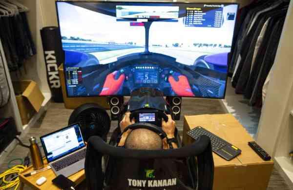 Brazilian IndyCar driver Tony Kanaan on his racing simulator (AP Photo/Michael Conroy)