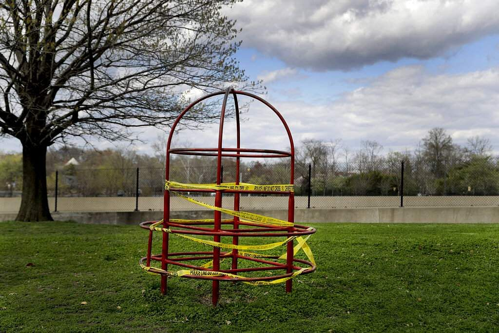 Playground equipment is wrapped in crime scene tape to prevent its use as part of the effort to slow the spread of the coronavirus in St Louis. (AP Photo/Jeff Roberson)
