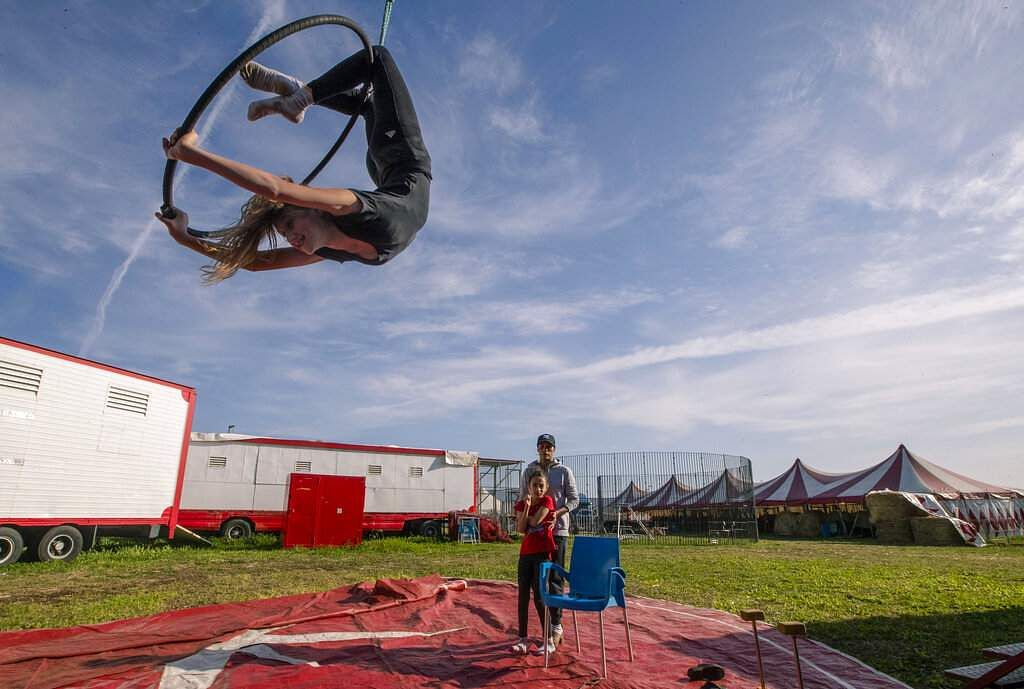 Otilia Maria stands with Asia as they look at 13-year-old Megan Vassallo training at the Rony Roller circus, on the outskirts of Rome. (AP Photo/Alessandra Tarantino)