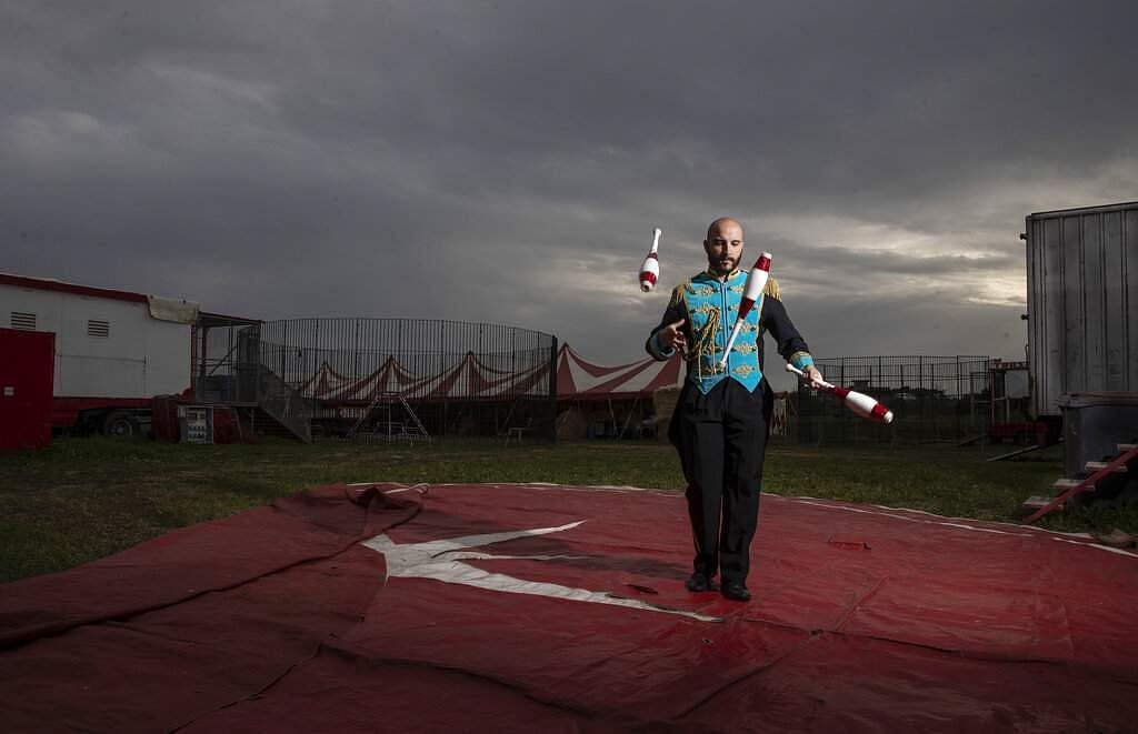 Clown and juggler Daniel Aanitei says, 'I am the clown but now I prefer to dress like this. I have no idea what the future will be like, I'm worried.' (AP Photo/Alessandra Tarantino)