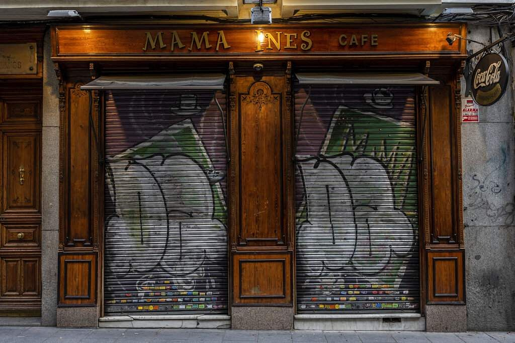 The entrance of a cafe closed during the coronavirus outbreak in Madrid, Spain. (AP Photo/Bernat Armangue)