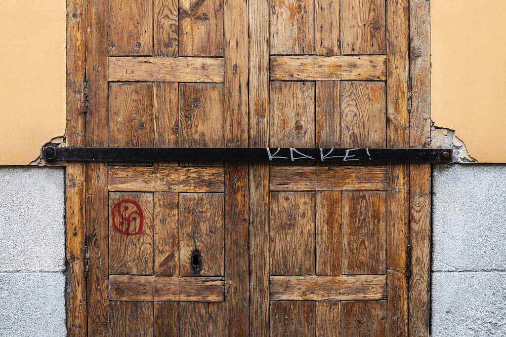 The entrance door of a shop closed during the coronavirus outbreak in Madrid, Spain. (AP Photo/Bernat Armangue)