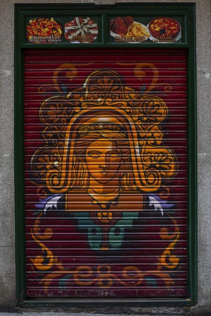 The roller shutter of a restaurant closed during the coronavirus outbreak in Madrid, Spain. (AP Photo/Bernat Armangue)