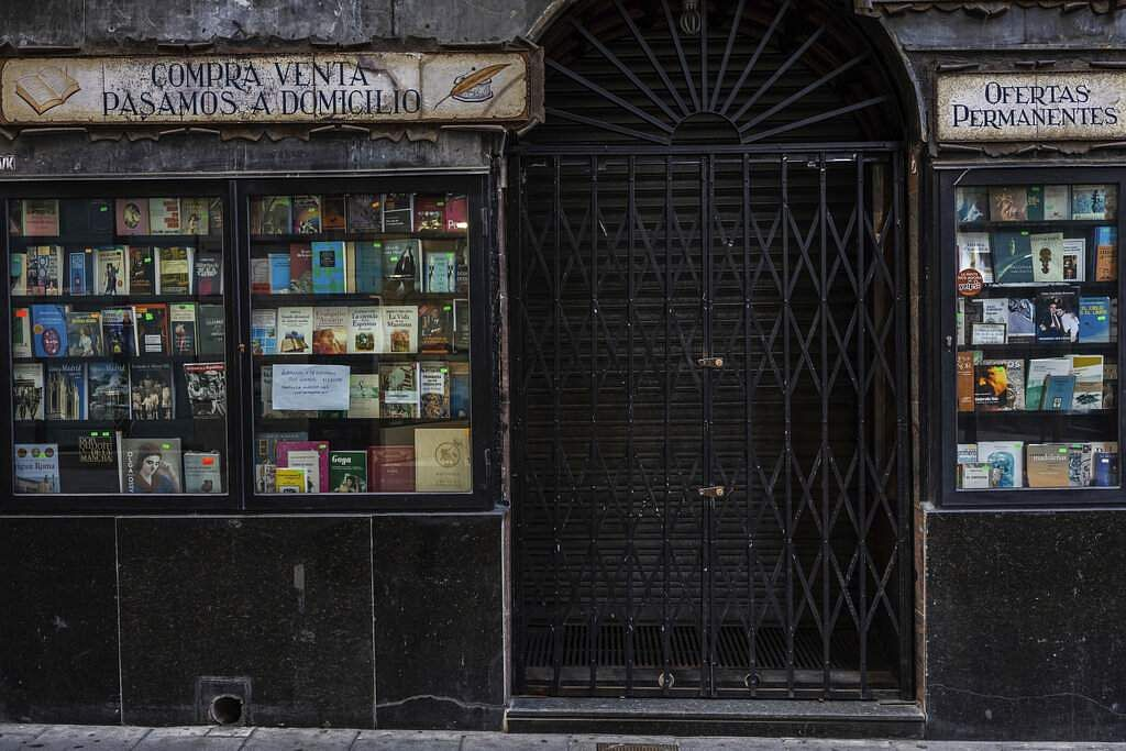 The entrance of a bookstore closed during the coronavirus outbreak in Madrid, Spain. (AP Photo/Bernat Armangue)