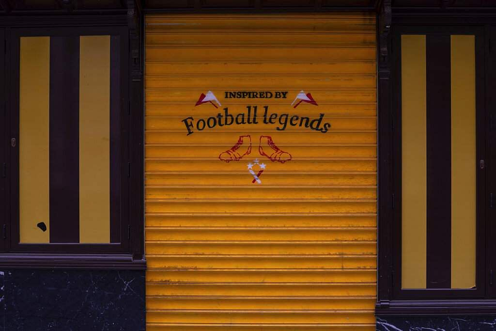 View of a retro vintage football shirts shop closed during the coronavirus outbreak in Madrid, Spain. (AP Photo/Bernat Armangue)