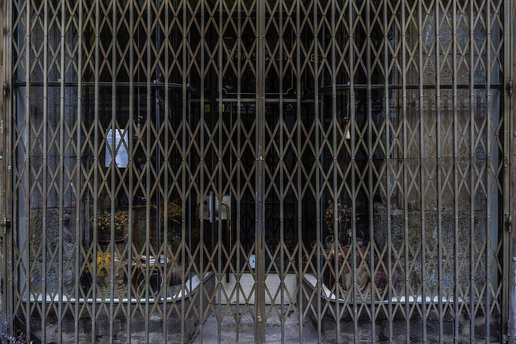 The entrance of a shop closed during the coronavirus outbreak in Madrid, Spain. (AP Photo/Bernat Armangue)