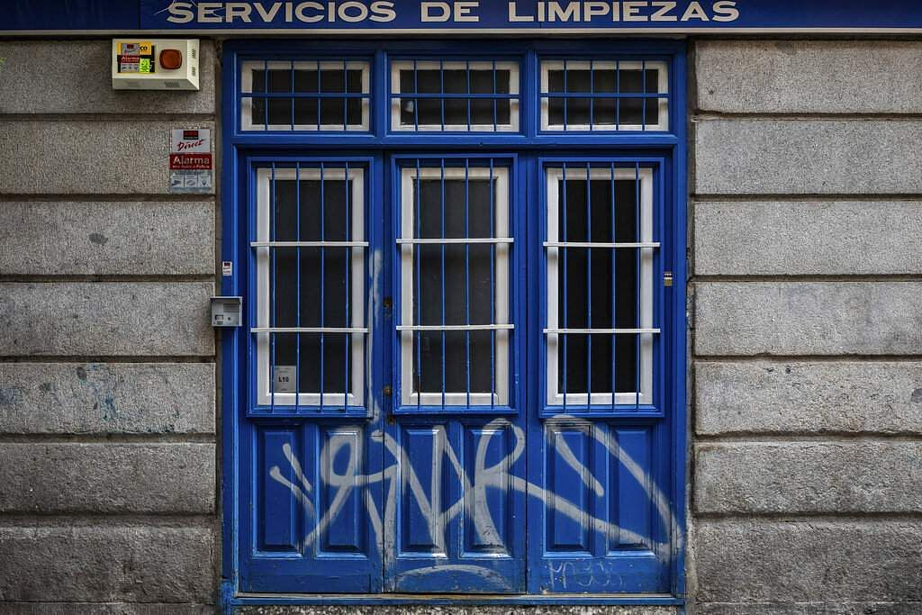 The entrance of a cleaning business closed during the coronavirus outbreak in Madrid, Spain. (AP Photo/Bernat Armangue)