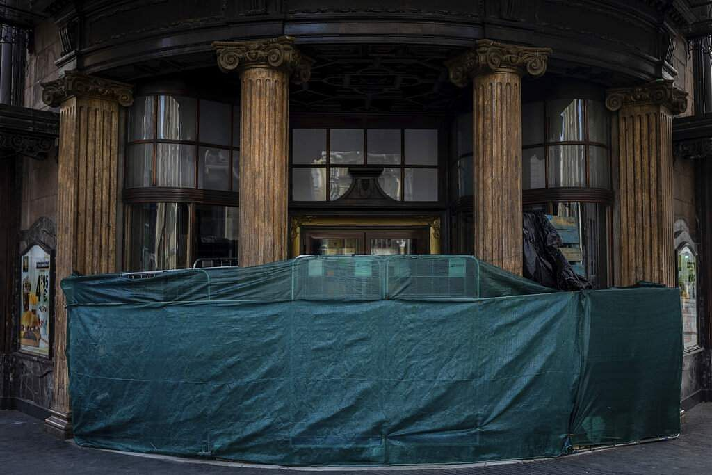 A makeshift structure blocks the entrance of a fast food restaurant closed during the coronavirus outbreak in Madrid, Spain. (AP Photo/Bernat Armangue)