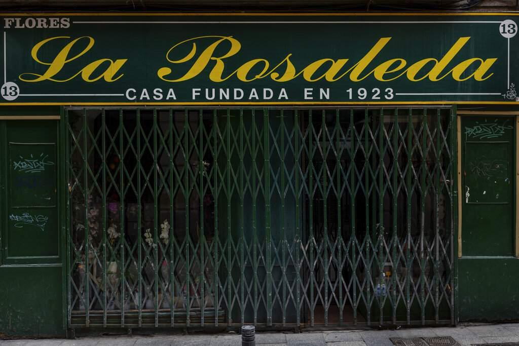 The facade of a florist shop closed during the coronavirus outbreak in Madrid, Spain. (AP Photo/Bernat Armangue)