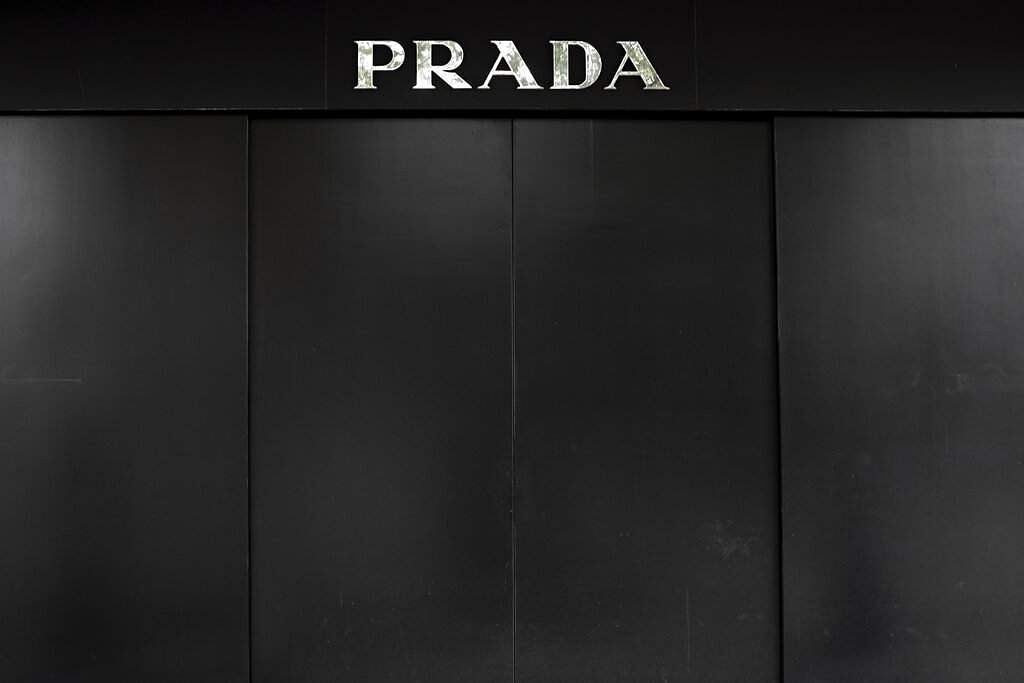 The entrance of a luxury fashion shop closed during the coronavirus outbreak in Madrid, Spain. (AP Photo/Bernat Armangue)