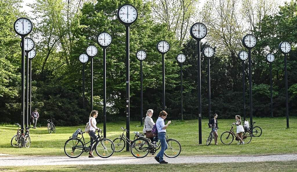 People with bicycles meet at the clock park in Duesseldorf, Germany, at 1800 on Friday April 24, 2020. (AP Photo/Martin Meissner)