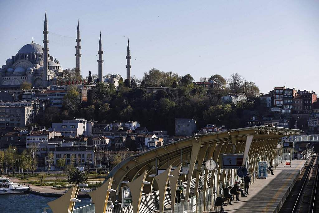 Backdropped by the iconic Suleymaniye Mosque in Istanbul, commuters wait at a metro station over the Golden Horn in Istanbul at 1800 on Friday, April 24, 2020. (AP Photo/Emrah Gurel)
