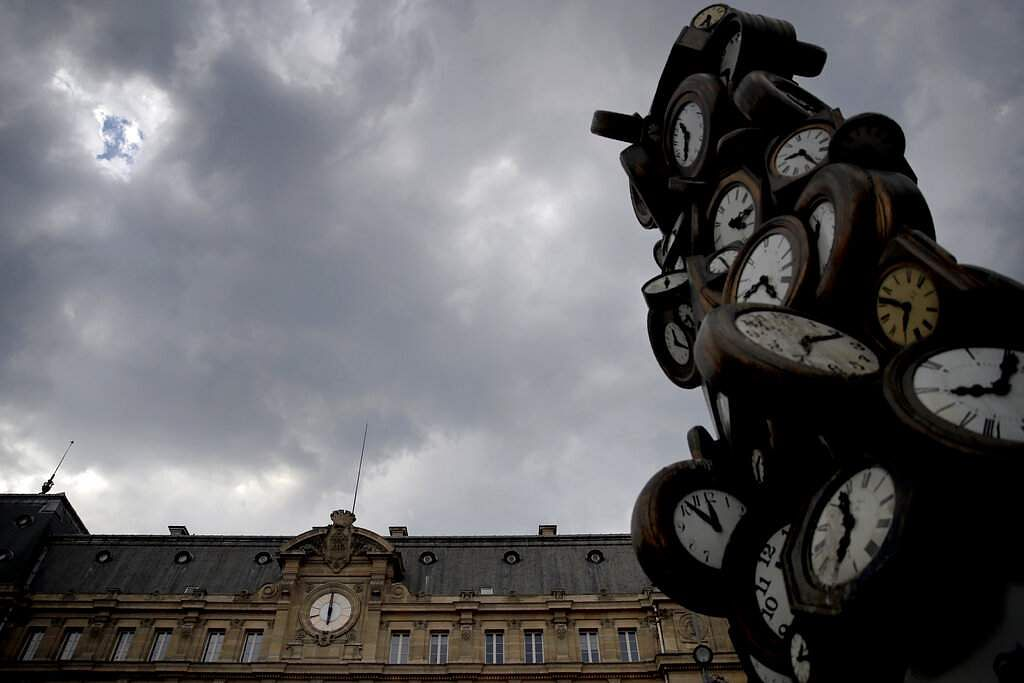 The Saint Lazare train station clock and the sculpture 'L'Heure de Tous' ('Everyone's Time') by French artist Arman in Paris is captured at 1800 on Friday April 24, 2020. (AP Photo/Christophe Ena)