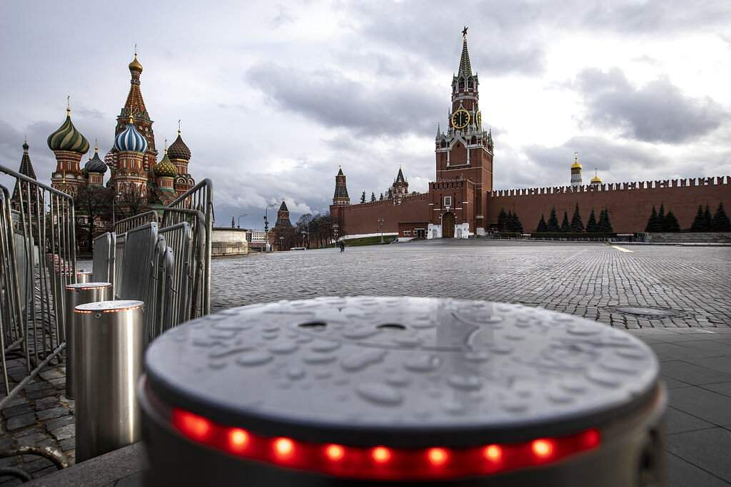 An empty Red Square with St Basil's Cathedral the Spasskaya Tower after a light rain at 18:00 on Friday, April 24, 2020 in Moscow, Russia. (AP Photo/Alexander Zemlianichenko)