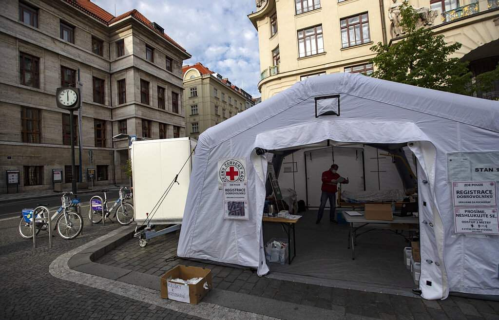 A Red Cross tent for volunteers to help fight the spread of coronavirus in front of the New Town Hall in Prague, Czech Republic at 1800 on Friday, April 24, 2020. (AP Photo/Petr David Josek)