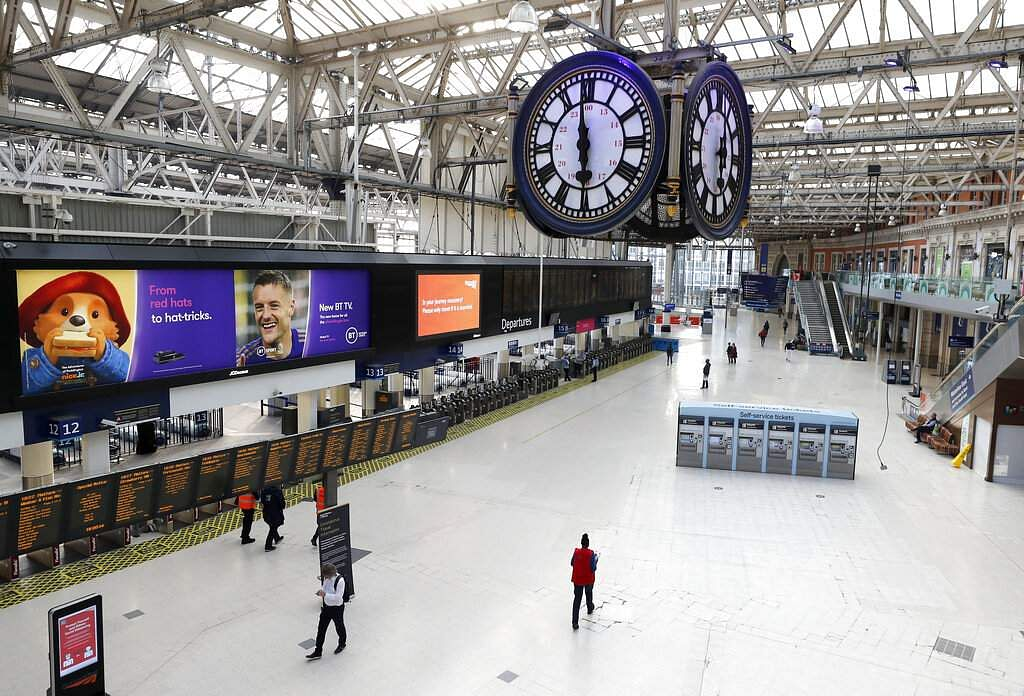 One of London's most famous rendezvous points is nearly empty under the Waterloo train station clock at 1800 in London, Friday, April 24, 2020. (AP Photo/Frank Augstein)