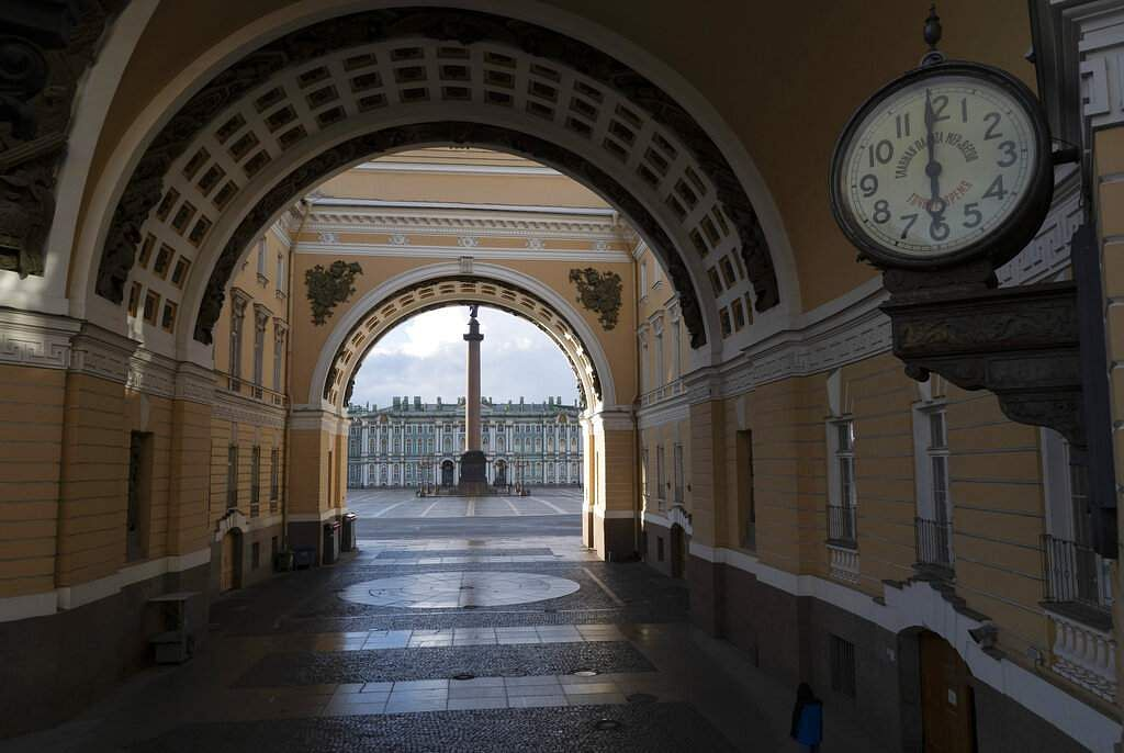 An empty Palace Square is seen through the arch of the General Staff Building in St Petersburg, Russia, at 1800 on Friday, April 24, 2020. (AP Photo/Dmitri Lovetsky)