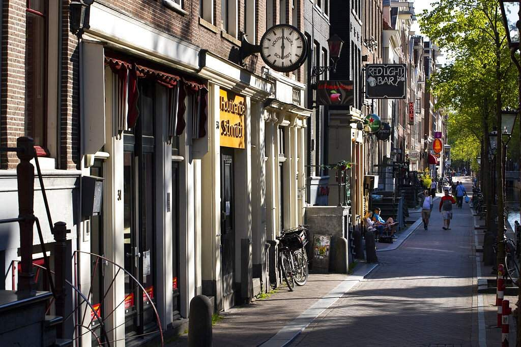 Adult booths, shows, clubs, movie theatres and stores are closed in a near-deserted Red Light District, Amsterdam, Netherlands at 1800 on Friday, April 24, 2020. (AP Photo/Peter Dejong)
