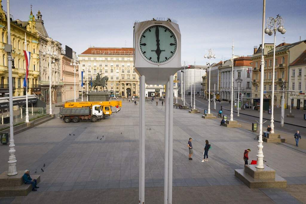 A view of the clock at the main square where machinery is parked for rebuilding works after the recent earthquake in Zagreb, Croatia at 1800 on Friday, April 24, 2020. (AP Photo/Darko Bandic)