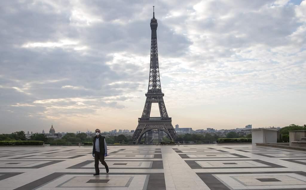 At the Eiffel Tower, Paris (AP Photo/Michel Euler, FILE)