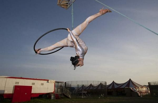 Otilia Maria Martinez Dos Santos performs at the Rony Roller circus on the outskirts of Rome. 'I miss the audience, the preparation, the emotion,' she says. (AP Photo/Alessandra Tarantino)