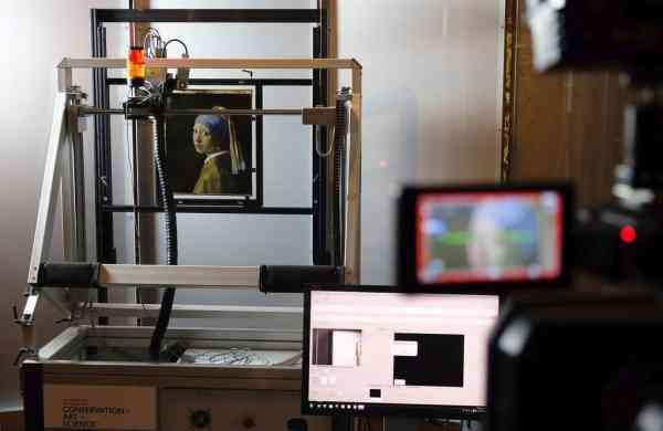 A scanner studies Vermeer's masterpiece (AP Photo/Mike Corder, FILE)