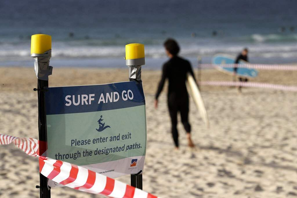 A sign tells surfers to leave once they have finished surfing at Bondi Beach in Sydney as pandemic restrictions are eased. (AP Photo/Rick Rycroft)
